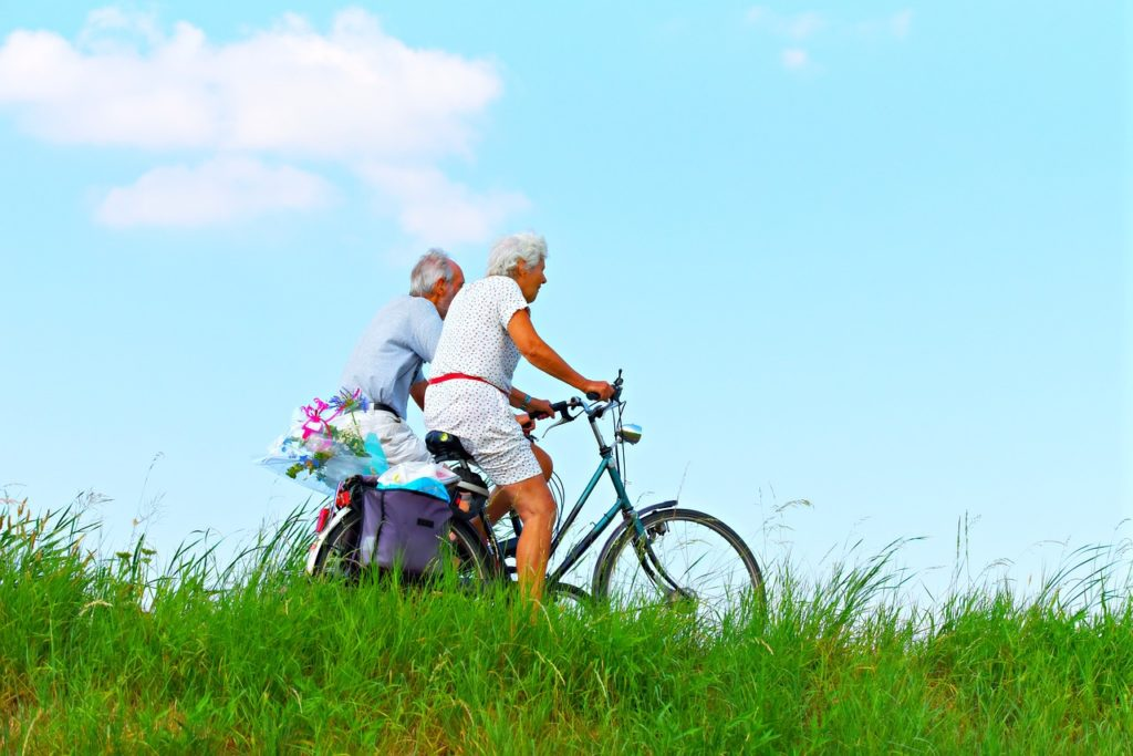 senior couple bicycling